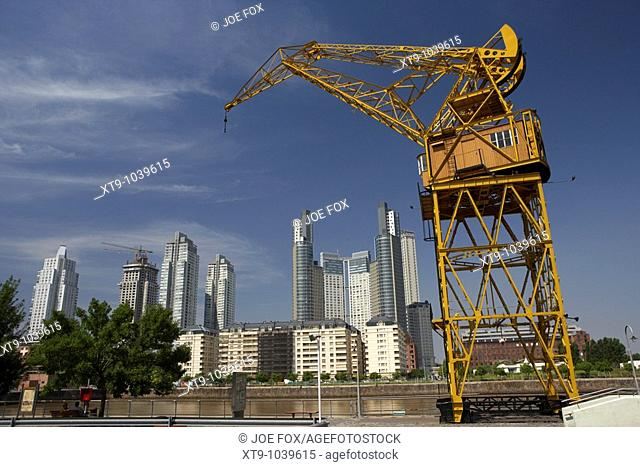 contrasting old harbour docks crane with modern high rise buildings in the dock area of puerto madero capital federal buenos aires republic of argentina south...