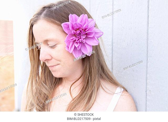 Mixed race woman wearing flower in her hair