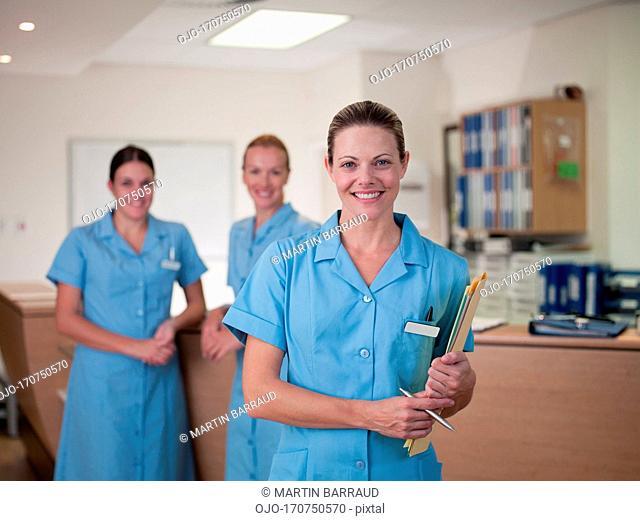Nurse holding medical chart in hospital