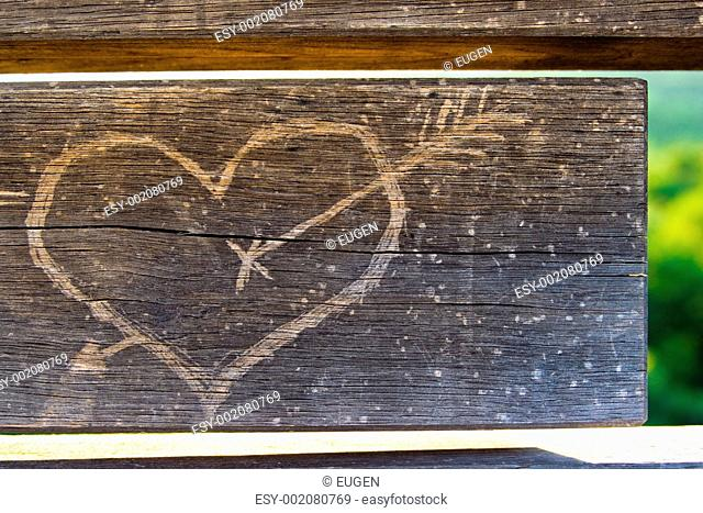 heart on wood with nice green background
