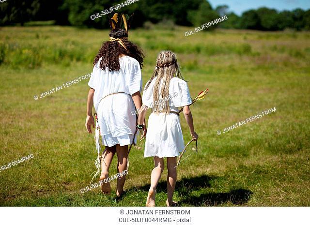 Girls walking in Native American costume