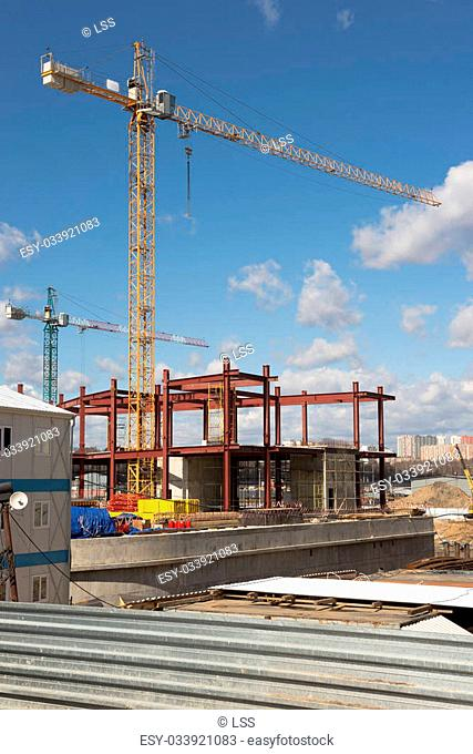 cranes at the construction site of the new building