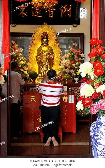 Man praying, Kek Lok Si Temple, Penang, Malaysia
