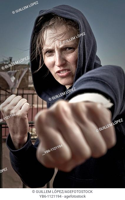 Young woman in fighting pose