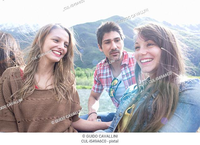 Group of three young adult friends laughing, Piemonte, Italy