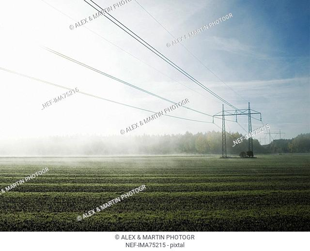 Electric lines above a foggy field, Sweden