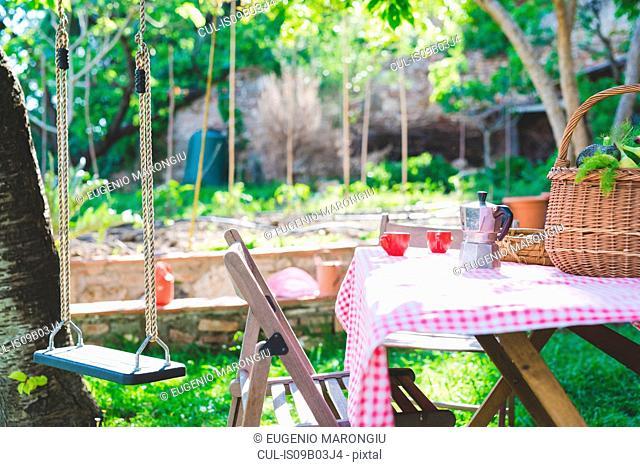 Garden table with espresso cups and espresso maker