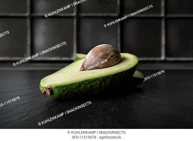 A halved avocado with a stone