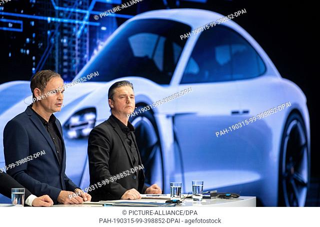 15 March 2019, Baden-Wuerttemberg, Stuttgart: Oliver Blume (l), CEO of Porsche AG, and Lutz Meschke, CFO of Porsche AG, are standing in front of a projection...