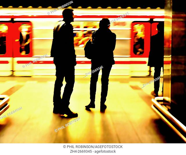 Prague, Czech Republic. Metro (underground railway) people and a train arriving - digitally manipulated