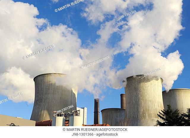 Coal fired power station Niederaussem emitting steam and smoke from cooling tower and smokestack, close up  Emissions by coal fired power stations are regarded...