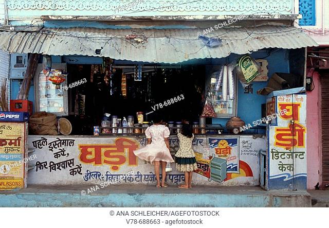 Two girls at grocery shop, Pushkar. Rajasthan, India