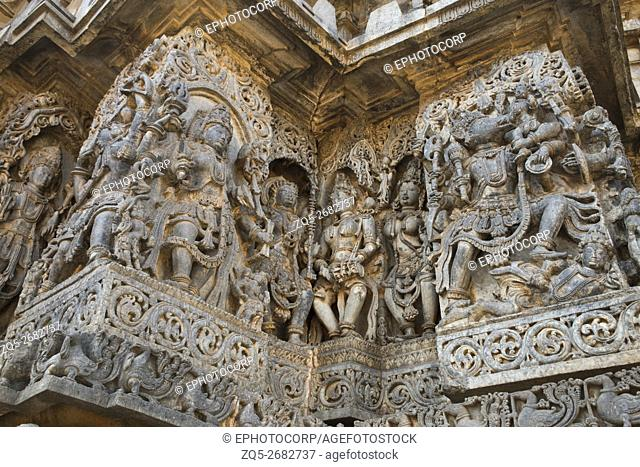 Sculptures west side walls. Shiva on the left and Varaha on the right. Hoysaleshwara temple, Halebidu, Karnataka, india. view from West