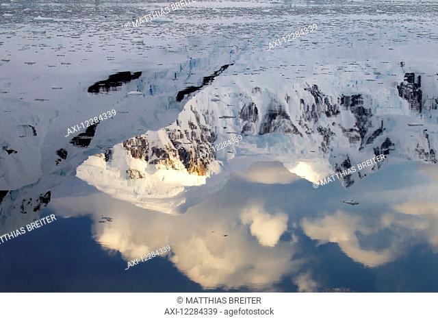 Sun on mountains in Paradise Harbor, Antarctic Peninsula; Antarctica