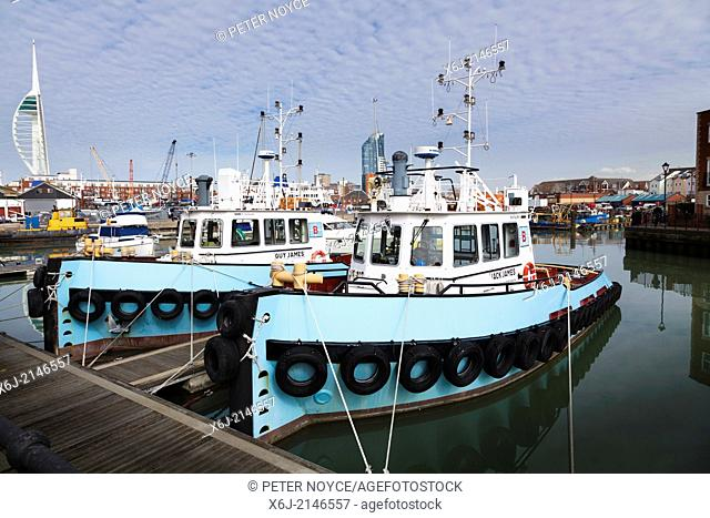Two Portsmouth tug boats moored in Portsmouth Harbour
