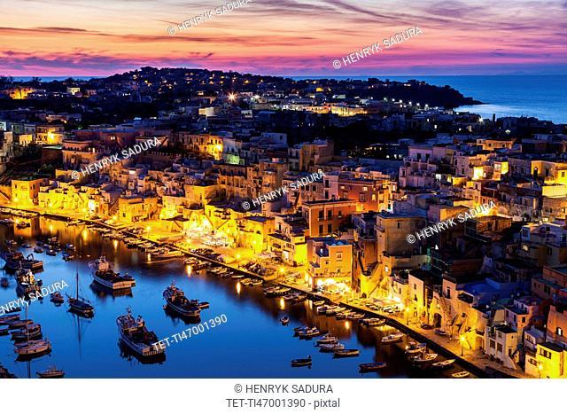 Illuminated townscape on Marina Corricella on Procida Island