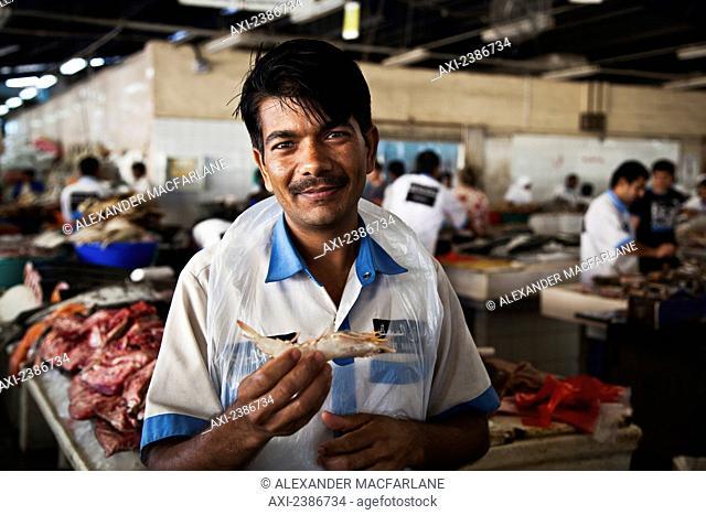 Worker in a fish market; Dubai, United Arab Emirates