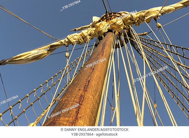 Close-up detail of a historic sailing ship, rigging, and mast in San Diego bay