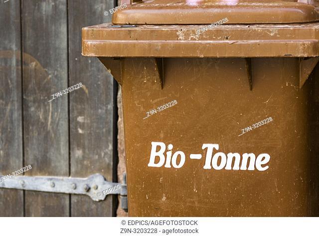 "brown trashcan with the german inscription: """"bio-tonne"""", trashcan for organic waste, stuttgart, baden-wuerttemberg, germany"