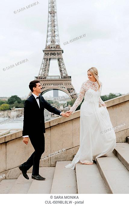 Bride and bridegroom, Eiffel Tower in background, Paris, France