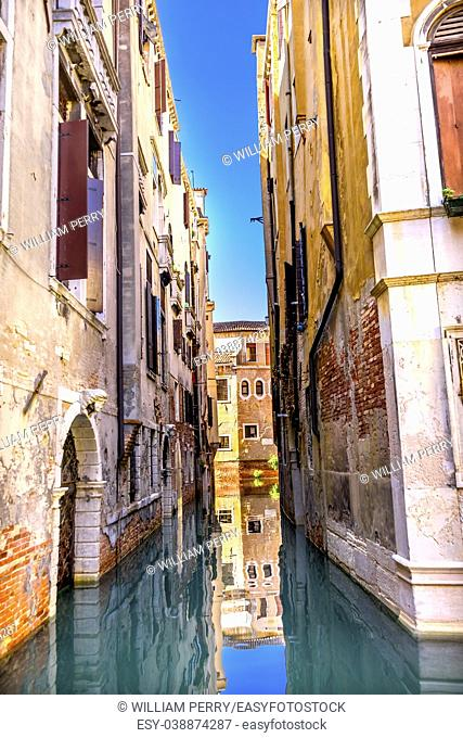 Colorful Small Canal Buildings Reflections Venice Italy