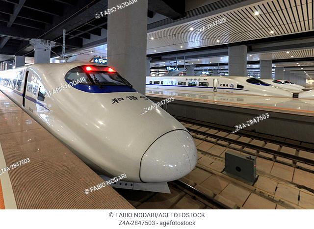 Kunming, China: Close up of a Chinese fast train inside the newly opened high speed train station in Kunming. The new fast train station links Kunming to...