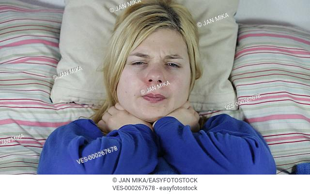 Sick woman resting in bed