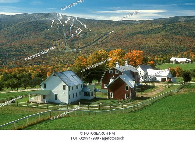 farm, fall, Fayston, VT, Vermont, Scenic view of the Green Mountains and Sugarbush Ski Resort at Mt. Ellen after the first snow from a farm in the Mad River...