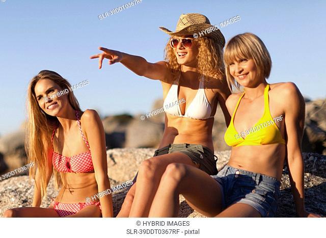 Women admiring beach together