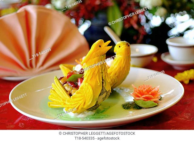 a dish of dessert with carving