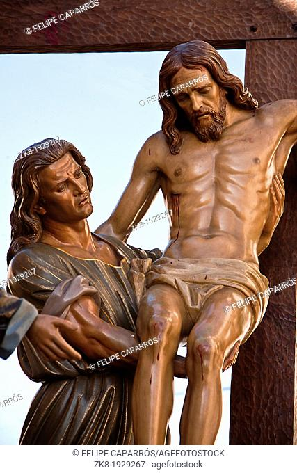 Wood carving of cedar of Spanish sculptor Victor de los Rios, represents the descent from the cross when Jesus was crucified, holy week in Spain