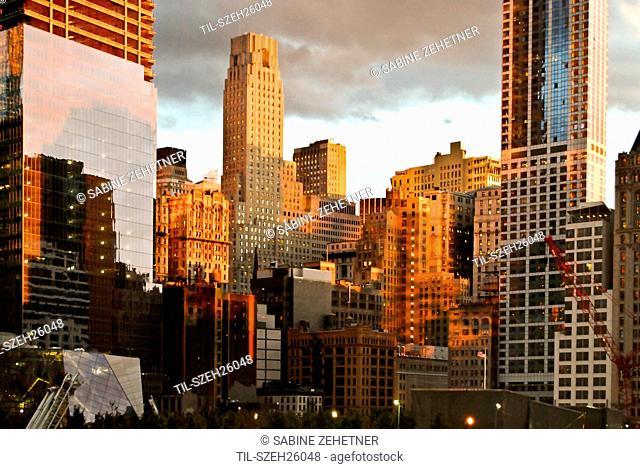 WTC site under construction with golden evening sunlight, Lower Manhattan, New York City