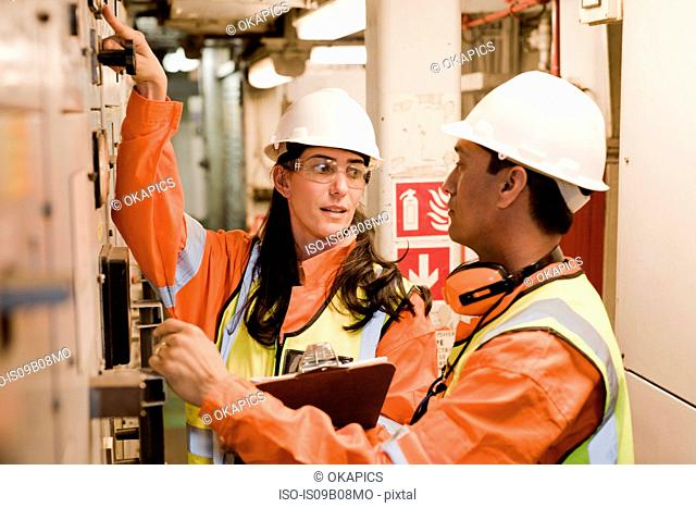 Engineers in discussion on oil rig
