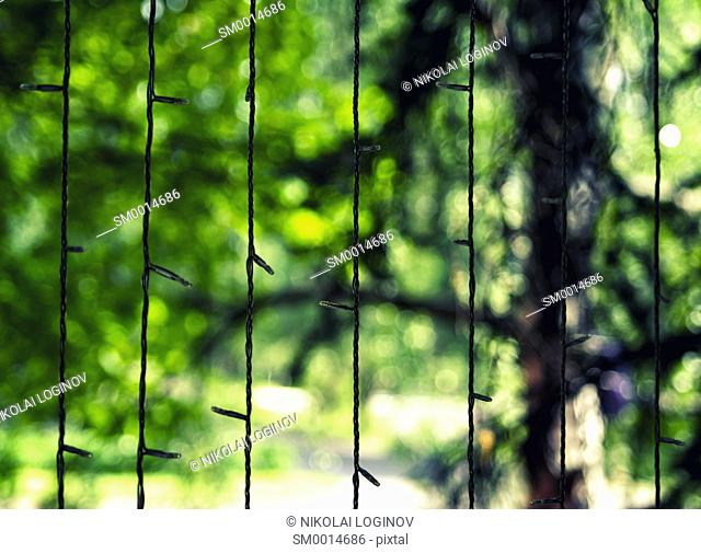 Vertical garland with green bokeh background backdrop