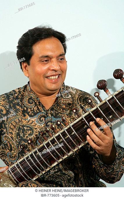 Indian musical instrument player Stock Photos and Images | age fotostock
