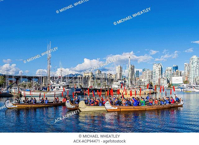 Canoes arrive at Fraser Fest, Vancouver, British Columbia, Canada