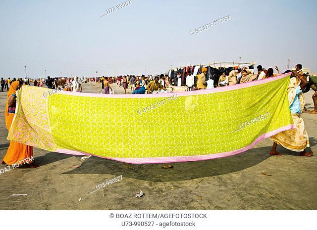 Drying up the sari on the beach of Gangasagar Island