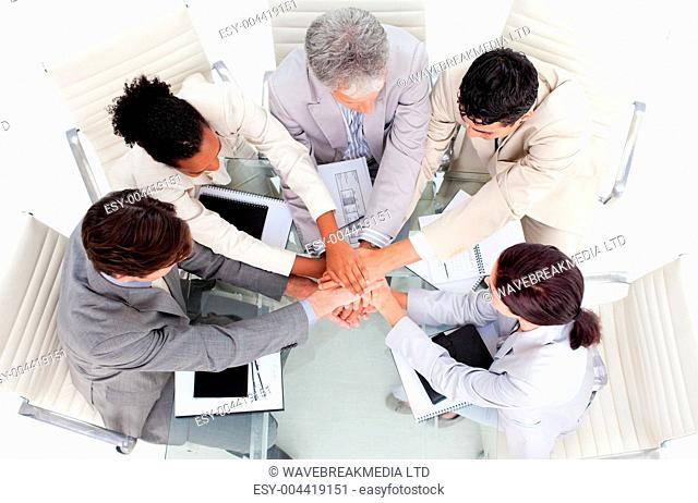 Cheerful inter tio l business people with hands together