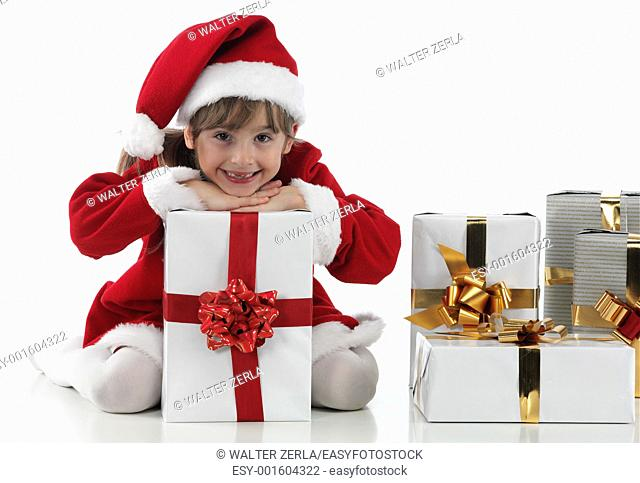 A little girl and xmas presents on white background