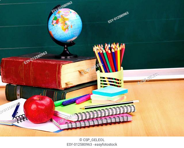 Books and blackboard. School supplies