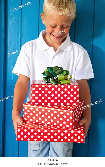 Boy looking down at gifts