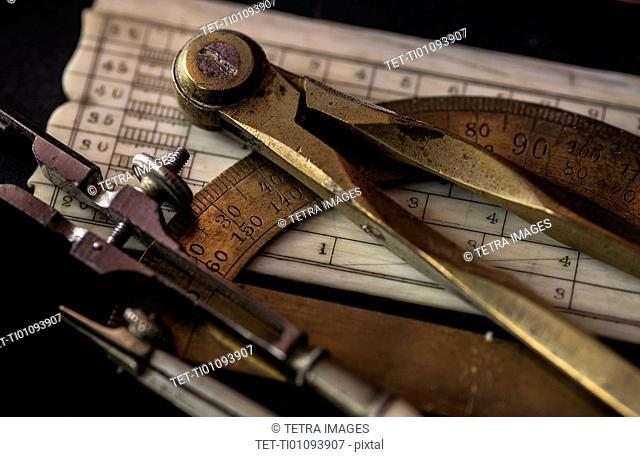 Studio shot of antique instruments of measurement