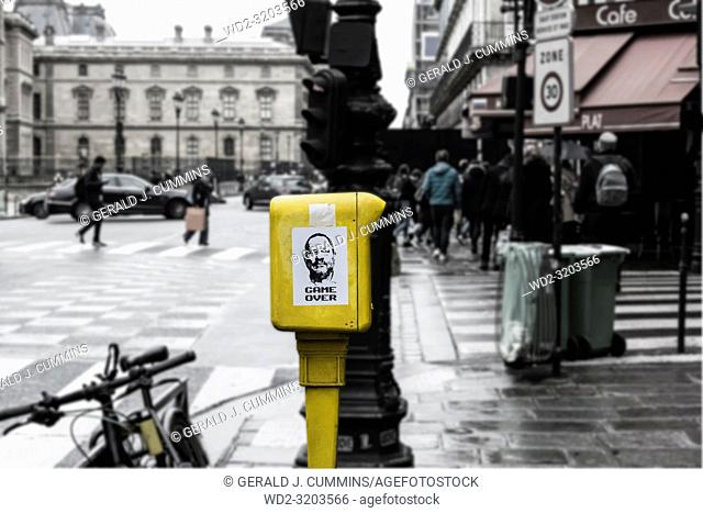 Image of the Hollywood film producer Harvey Weinstein produced by an unknown Parisien urban artist One Bats, stuck to a french letterbox