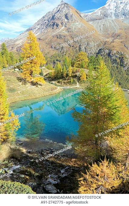 """Switzerland, Valais, Val d'Herens, village of Evolene and surroundings at fall, La Gouille, the """"""""blue lake"""""""""""