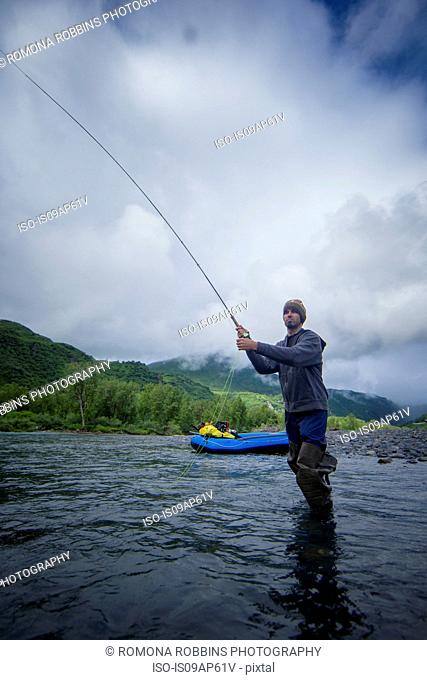 Man fishing in river, Kodiak, Alaska, USA