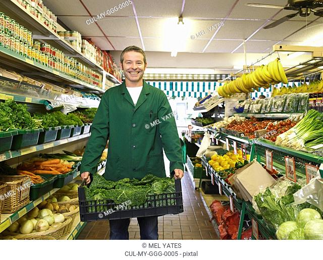 Grocer carrying some fresh vegetables