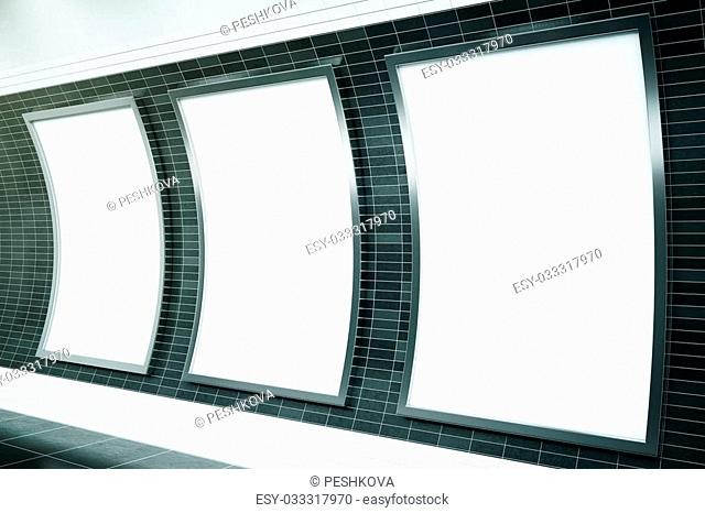 Side view of three empty ad posters in metro station with dark tile walls. Mock up, 3D Rendering