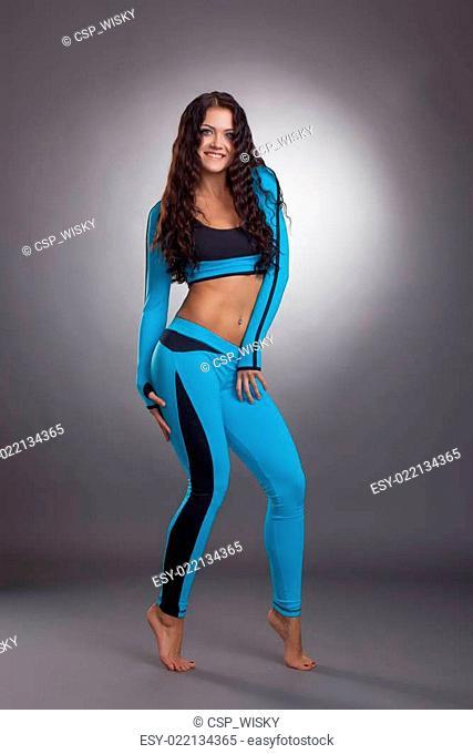 Beautiful female athlete posing in studio