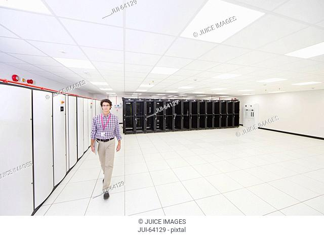 Technician walking towards camera in server room