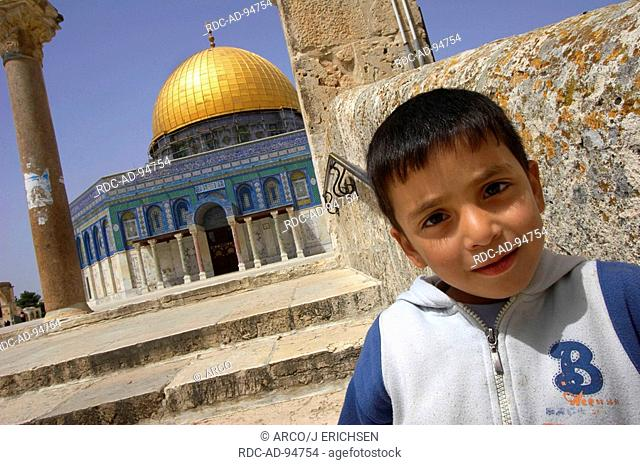 Palestine boy in front of the Dome of the Rock Temple Mount old part of Jerusalem Israel